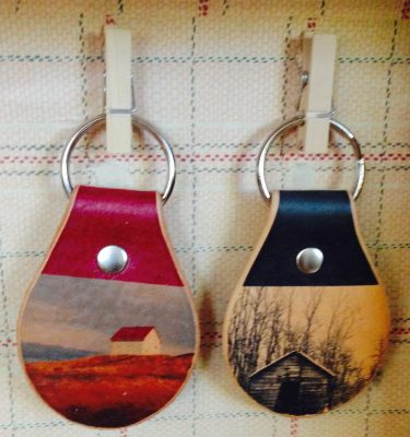 blue dirt girl merchandise leather keychain with either Piggery or Saturna tattooed image
