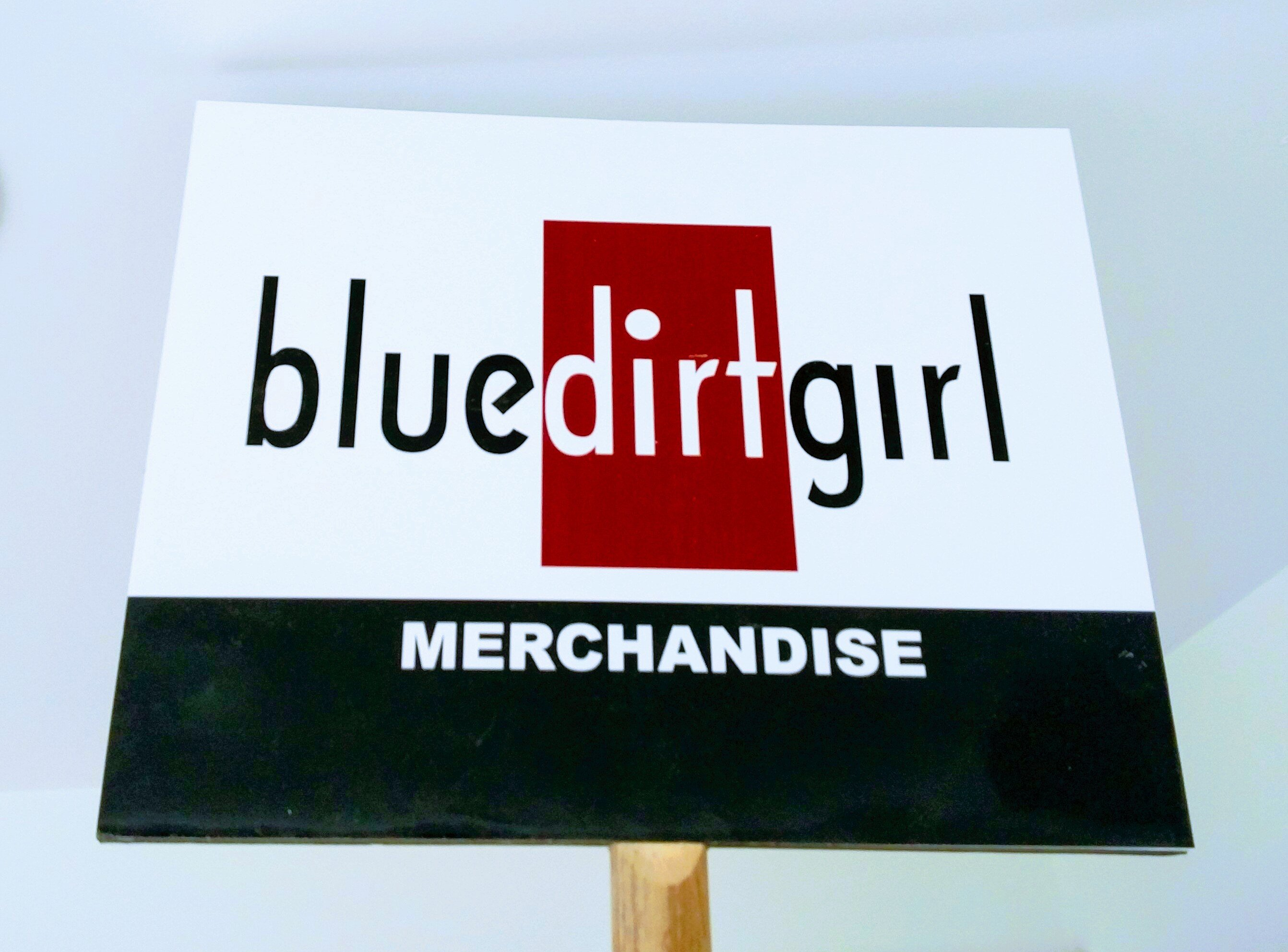 blue dirt girl new merch sign