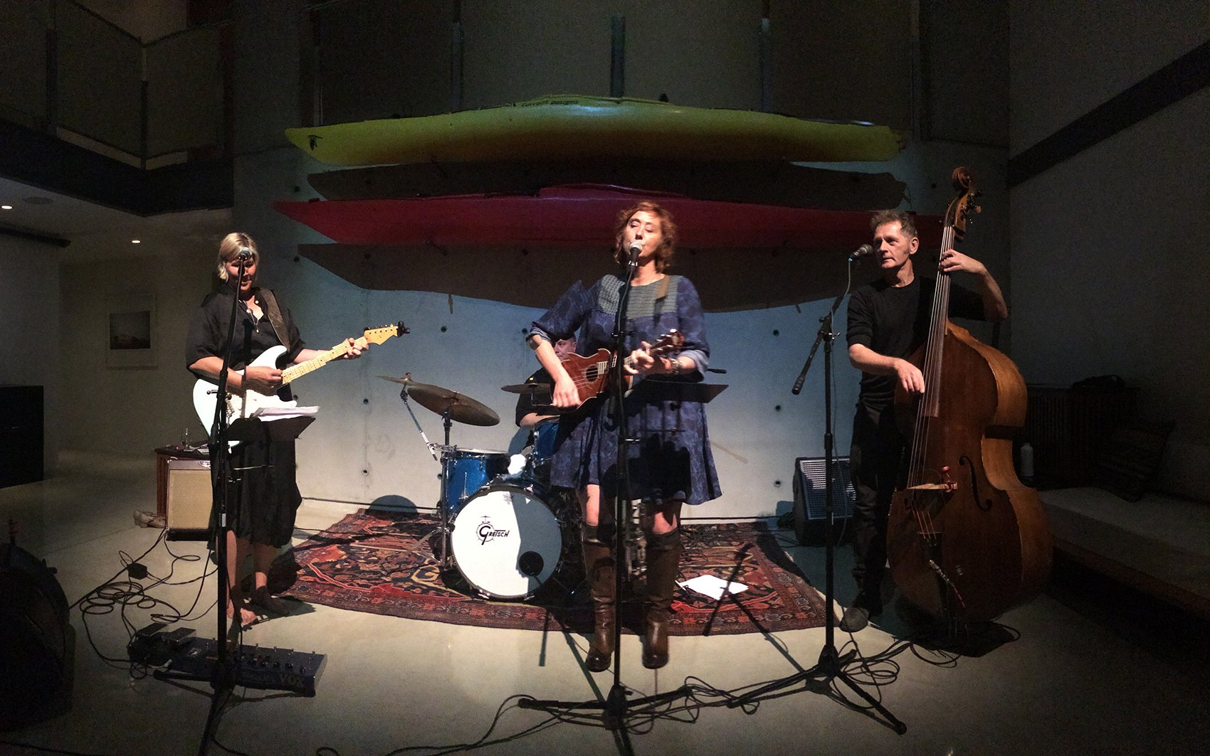 Moira Chicilo performing with blue dirt girl